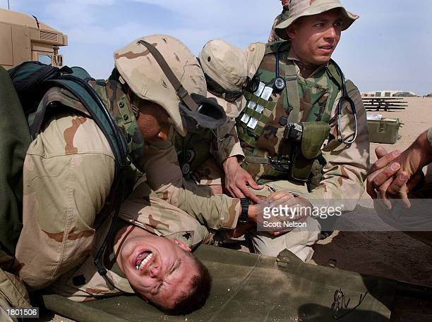 S Marine Jason Delonais from Lawton Oklahoma plays the role of a simulated wounded solider as Marines of the 117th Combat Services Support Company...