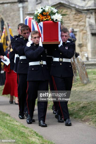 Marine Jason Mackie's coffin is carried from St Mary's Church in Bampton, Oxfordshire, following his funeral.
