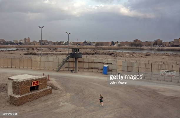 Marine jogs inside blast walls of the compound of the American Embassy near the Euphrates River February 5, 2007 in Baghdad, Iraq . The platoon of...