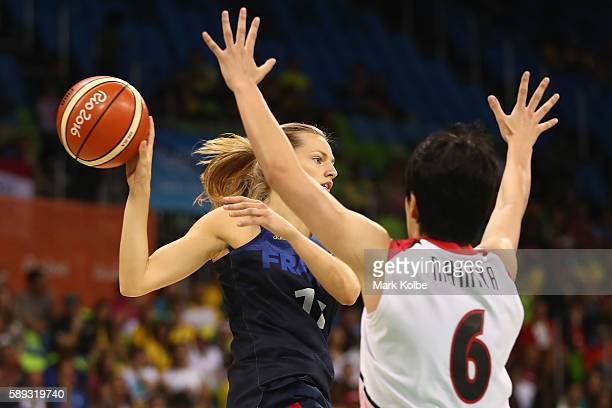 Marine Johannes of France passes during the Women's preliminary round group A basketball match between Japan and France on Day 7 of the Rio 2016...