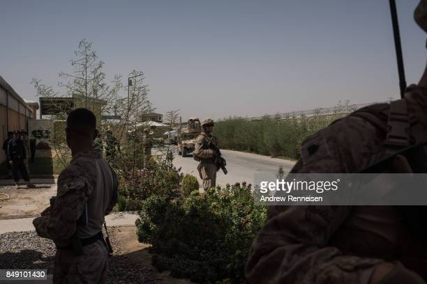 S marine keeps watch during a meeting between Afghan commanders and US advisors at Camp Bost on September 11 2017 in Helmand Province Afghanistan...