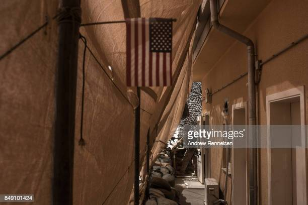 S marine keeps watch from his post at Camp Bost on September 11 2017 in Helmand Province Afghanistan About 300 marines are currently deployed in...