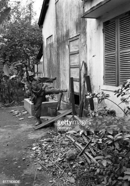 A marine kicks in door during housetohouse battle with Viet Cong in this old imperial capital of Hue The enemy flag still flew above the citadel in...
