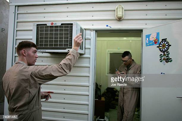 S Marine Lance Corporal Adam W Schenk from Bolivar Missouri and Douglas R Tripp from Texline Texas of the 2/7 Marines play a game of darts outside...