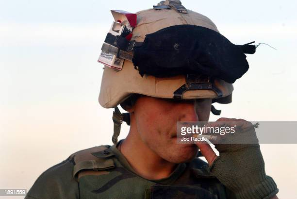 Marine Lance Corporal Gino Detone from Ann Arbor, Michigan of Task Force Tarawa smokes a cigarette April 2, 2003 in the southern Iraqi city of...