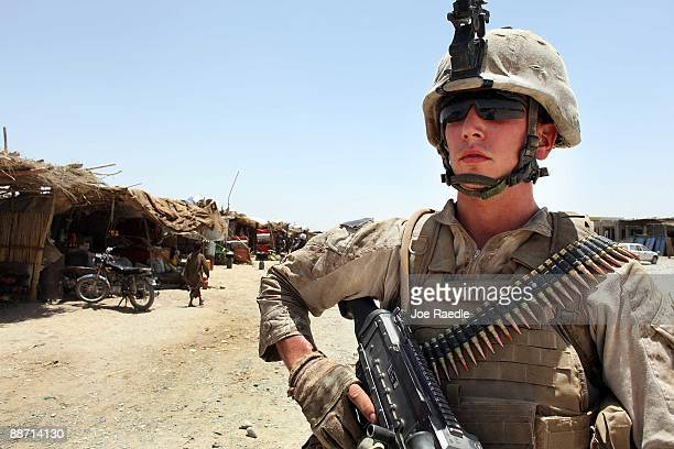 S Marine Lance Corporal Matt Palozola from St Louis Missouri of the 2nd Marine Exhibitionary Brigade 2nd Battalion 3rd Marines Echo Company walks...