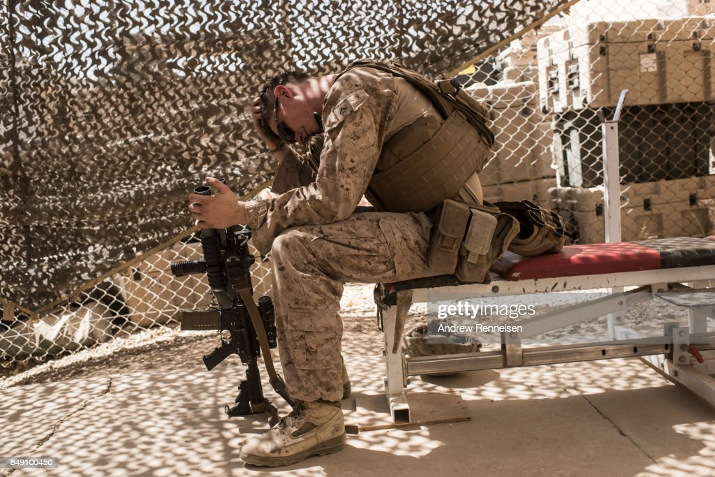 U.S. marine Lance Corporal Michael McLeod, 20, from New Jersey rests on a bench in a gym at Camp Bost on September 11, 2017 in Helmand Province, Afghanistan. About 300 marines are currently deployed in Helmand Province in a train, advise, and assist role supporting local Afghan security forces. Currently the United States has about 11,000 troops in the deployed in Afghanistan, with a reported 4,000 more expected to arrive in the coming weeks. Last month, President Donald Trump announced his plan for Afghanistan which called for an increase in troop numbers and a new conditions-based approach to the war, getting rid of a timetable for the withdrawal of American forces in the country.