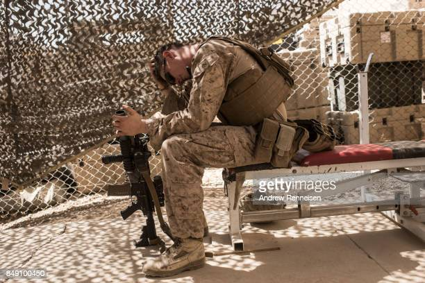 S marine Lance Corporal Michael McLeod from New Jersey rests on a bench in a gym at Camp Bost on September 11 2017 in Helmand Province Afghanistan...