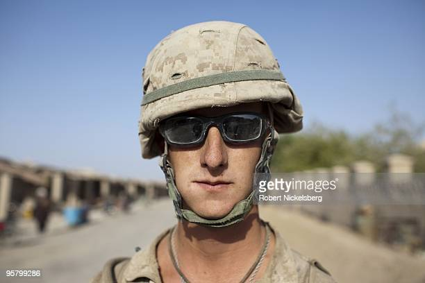 Marine Lance Corporal Nathan May 21 years from Lufkin Texas patrols the partially deserted market August 13 2009 in Khan Neshin Afghanistan LCpl May...