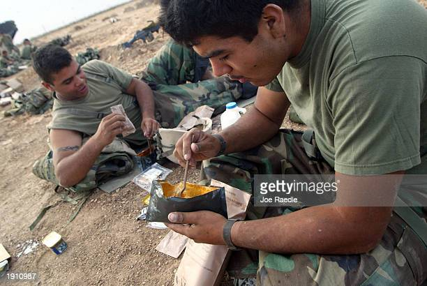 S Marine Lance Corporal Pedro Rodriquez from Methuen Massachusetts and Lance Corporal Miguel Ochoa from Mountainview California of Task Force Tarawa...