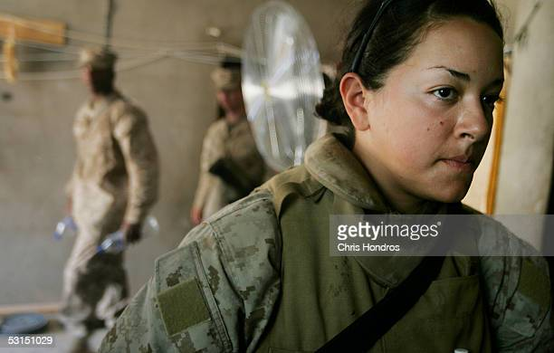 Marine Lance Cpl Jillian Masmela of Boston Massachusetts stands inside just before her shift as a female searcher at Entry Control Point 1 a guarded...