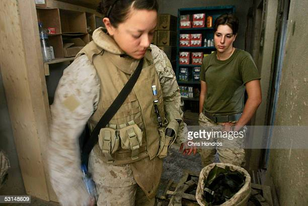 Marine Lance Cpl Jillian Masmela of Boston Massachusetts stands inside with fellow Marine Cpl Courtney Waddell of Angola New York just before her...