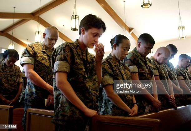 S Marine Lance Cpl Nicole Fuller wipes tears from her face during a memorial service for Cpl Armando Gonzalez at the Marine Corps Air Station chapel...