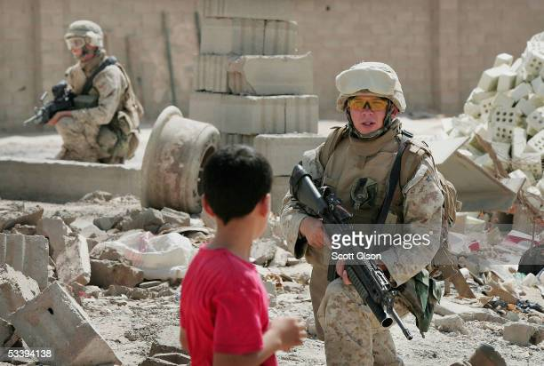Marine LCpl. Brian Norcoss and LCpl. Joshua Wall from Golf Company 2nd Battalion 7th Marines set up security during a patrol on August 16, 2005 in...
