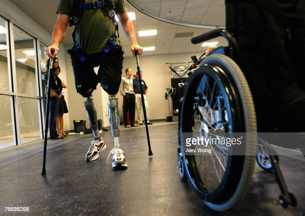 Marine LCpl Joshua Bleill of 1/24 4th Marine Division who was injured in October 2006 in Fallujah Iraq walks with prosthetic limbs at the newly...