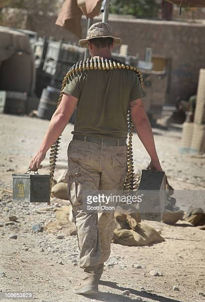 S Marine LCpl Scott Gilbert of Colwich KS with India Battery 3rd Battalion 12th Marine Regiment puts away ammunition following a patrol at Forward...