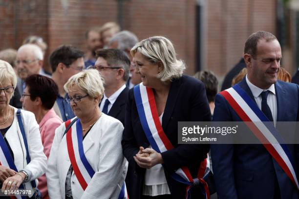 Marine Le Pen and HeninBeaumont's mayor Steeve Briois attend France Bastille Day official ceremony on July 14 2017 in HeninBeaumont France The French...