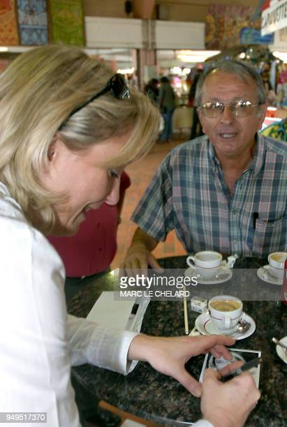 Marine Le Pen daughter of farright National Front leader JeanMarie Le Pen and party's Vice President signs an autograph for a supporter 02 December...