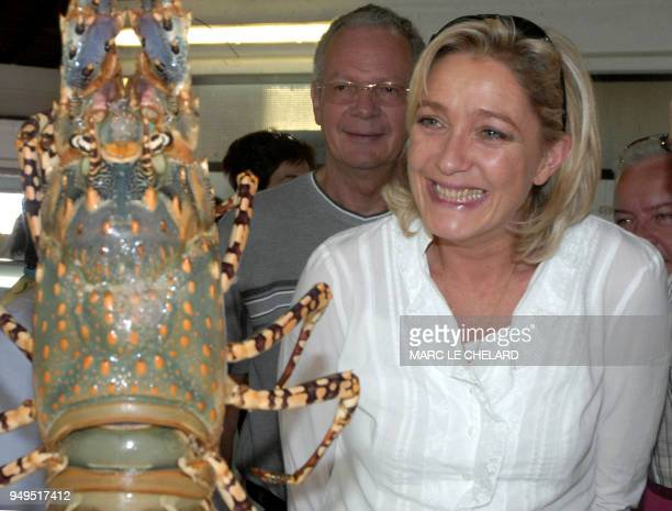 Marine Le Pen daughter of farright National Front leader JeanMarie Le Pen and party's Vice President looks at a Lagoon lobster as she meets supporter...