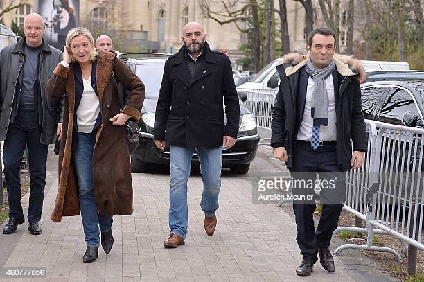 Marine Le Pen France far right National Front president and Florian Philippot National Front vice president visit the Christmas Market on the Champs...