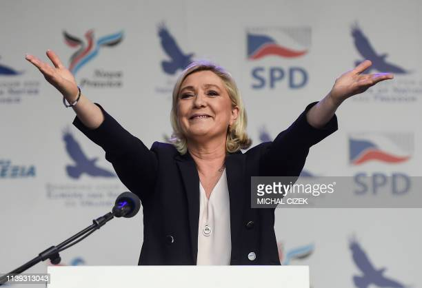 Marine Le Pen head of France's National Rally party delivers her speech during a conference of the rightwing Europe of Nations and Freedom group in...