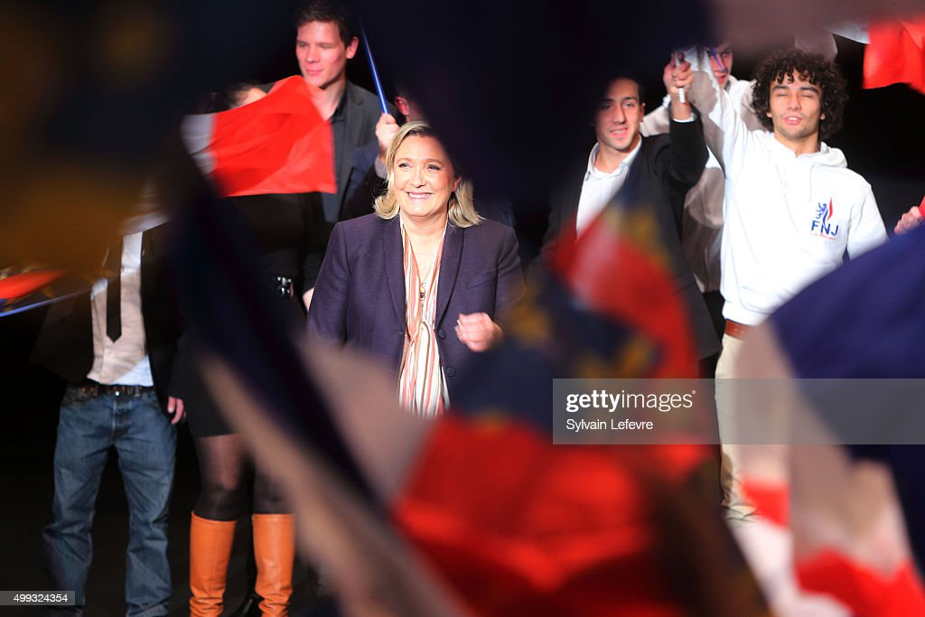 Marine Le Pen, leader of the French far-right National Front (FN) party, smiles at the end of her campaign rally for the upcoming regional elections in the Nord-Pas de Calais-Picardie, on November 30, 2015 in Lille, France.