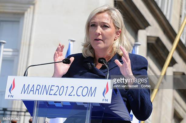 Marine Le Pen new leader of the far right wing Front National and French presidential candidate for the 2012 elections marches through the streets of...