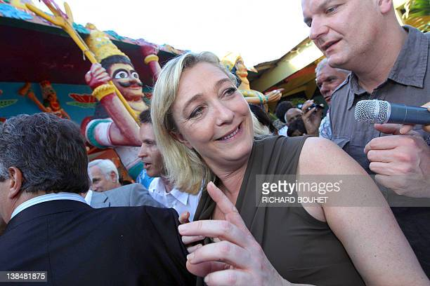 Marine Le Pen President of French farright party Front national and candidate for the 2012 French presidential election arrives to visit the 'Etang...