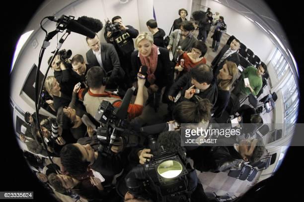 Marine Le Pen répond aux questions des journalistes le 15 mars 2010 au siège du Front National à Nanterre au lendemain du premier tour des élections...