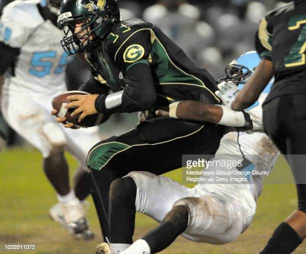 CITY 11/06/09 Marine League battle between the Carson Colts and the Narbonne Gauchos 1st half Narbonne QB Chad Dashnaw is sacked by Daniel Acevedo