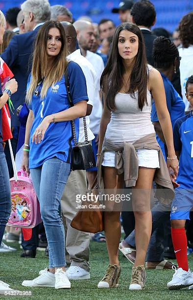 Marine Lloris wife of Hugo Lloris and Ludivine Sagna wife of Bacary Sagna of France look on following the UEFA EURO 2016 round of 16 match between...