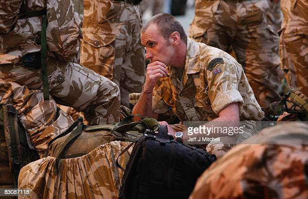 Marine looks on as eighty Royal Marines of Zulu company 45 Commando prepare to leave their base RM Condor for six months tour of Afghanistan on...