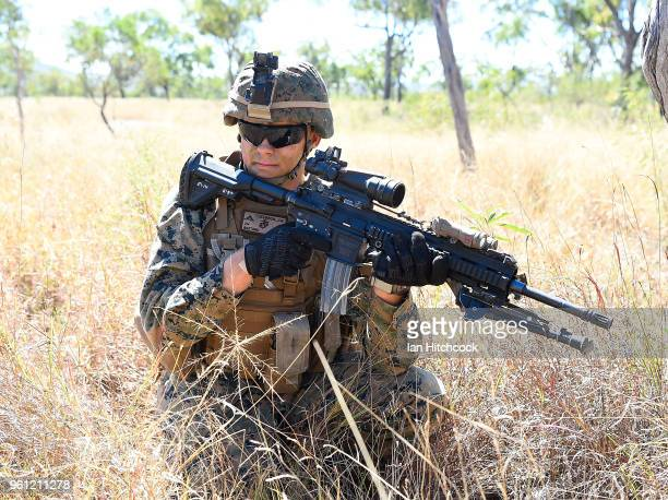 Marine looks on during an attack on a simulated defensive position during Exercise Southern Jackaroo on May 22 2018 in Townsville Australia Exercise...