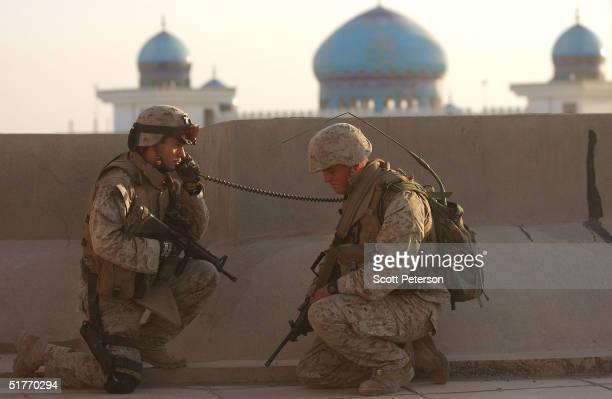 S Marine Lt Michael Aubry from Arlington Heights Illinoi of the 1st Light Armored Reconnaissance company makes a radio call November 20 2004 in...