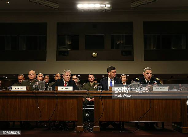 US Marine Major General Walter Lee Miller Jr US Secretary of the Navy Ray Mabus acting Secretary of the US Army Patrick J Murphy and US Army Chief of...