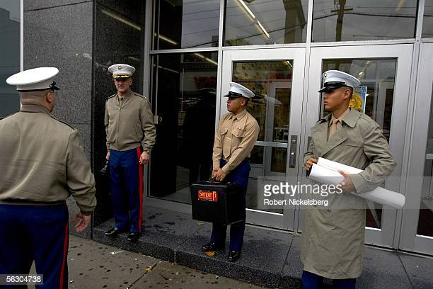 US Marine Major Kevin Norton stands with three Marines in front of Hoboken High School after addressing senior students during a Marine recruitment...