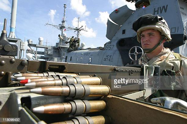 A marine mans a 50 caliber heavy machine gun from the deck of the USS Mount Whitney stationed in the Gulf of Aden off the coast of Djibouti The Mount...