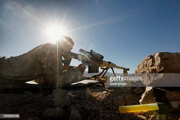 S Marine marksman Cpl Jacob Hoag of Bend OR with India Battery 3rd Battalion 12th Marine Regiment sets up a sniper position to provide security for a...