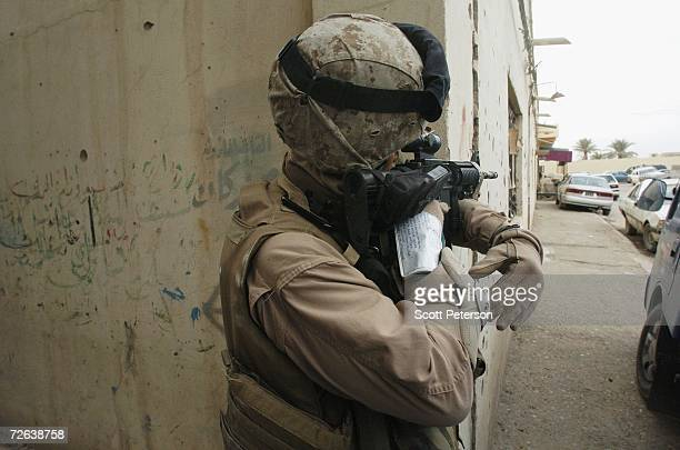 Marine of the 4th Civil Affairs Group keeps security on November 23 2006 in Fallujah Iraq Iraqis are trying to rebuild partly using $200 million in...