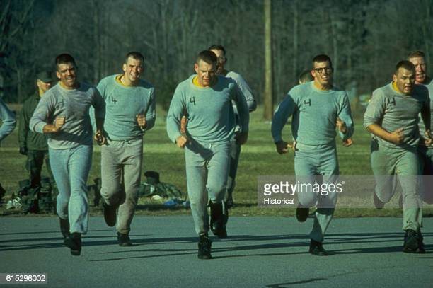 Marine officer candidates run during their daily physical training while attending the Officer Candidate School Marine Corps Development and...