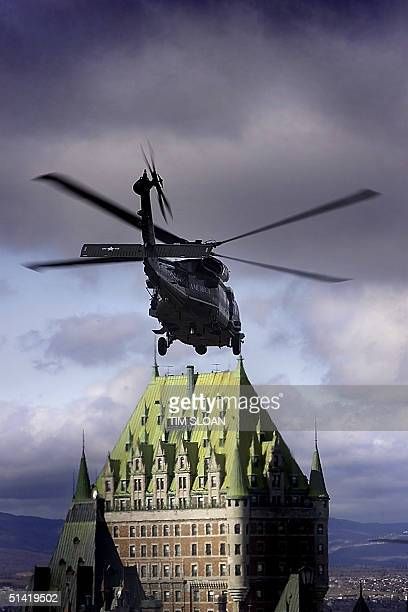 Marine One carry US President George W Bush flies over the historic Chateau Frontenac at the end of the III Summit of the Americas 22 April 2001 in...