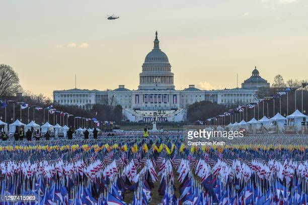 Marine One carrying President Donald Trump and first lady Melania Trump as they departed from the White House flies over the U.S. Capitol ahead of...