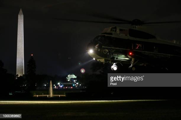 Marine One carrying President Donald Trump and First Lady Melania Trump arrive on the South Lawn of the White House on July 16 2018 in Washington DC...