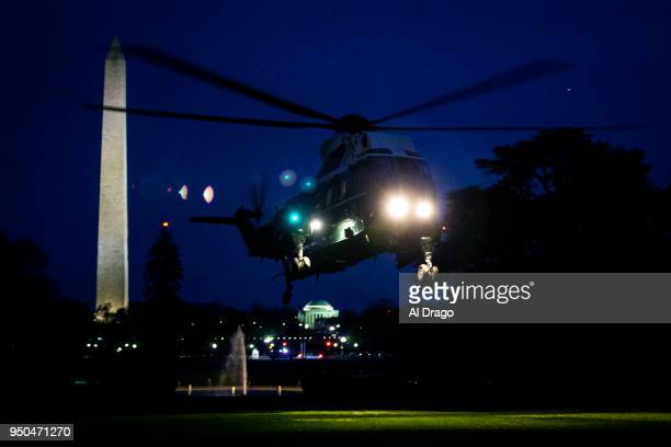 Marine One carrying President Donald Trump French President Emmanuel Macron Brigitte Macron and first lady Melania Trump arrives on the South Lawn of...