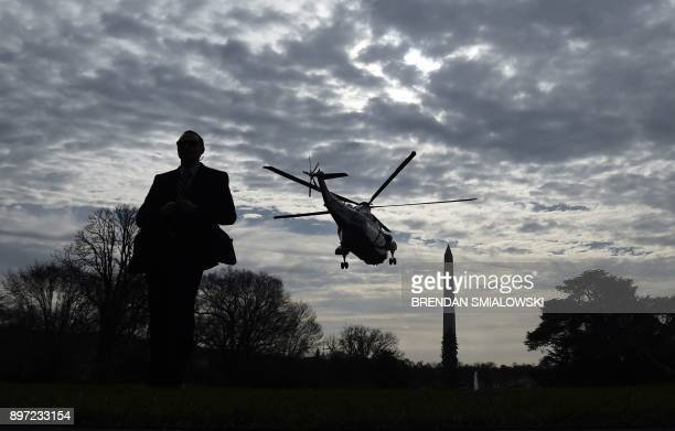 TOPSHOT Marine One carrying United States President Donald J Trump departs the White House in route to Joint Base Andrews on December 22 2017 in...