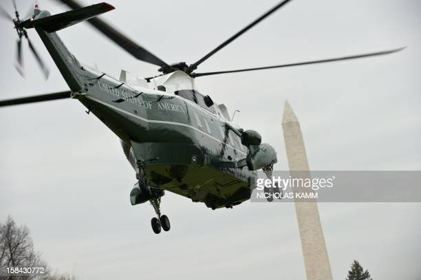 Marine One carrying US President Barack Obama departs the White House in Washington on December 16, 2012. Obama is due in the small Connecticut...