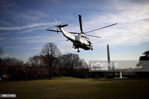 Marine One carrying US President Donald Trump departs the White House December 21 2017 in Washington DC Trump was scheduled to visit US service...