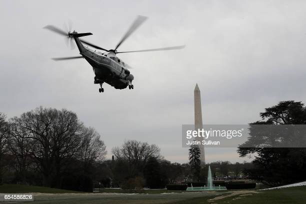 Marine One carrying US President Donald Trump First Lady Melania Trump and son Barron Trump departs from the White House on March 17 2017 in...