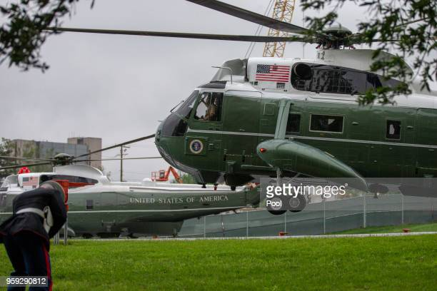 Marine One carrying US President Donald Trump lands on the helipad at exits at Walter Reed Medical Center on May 16 2018 in Bethesda Maryland