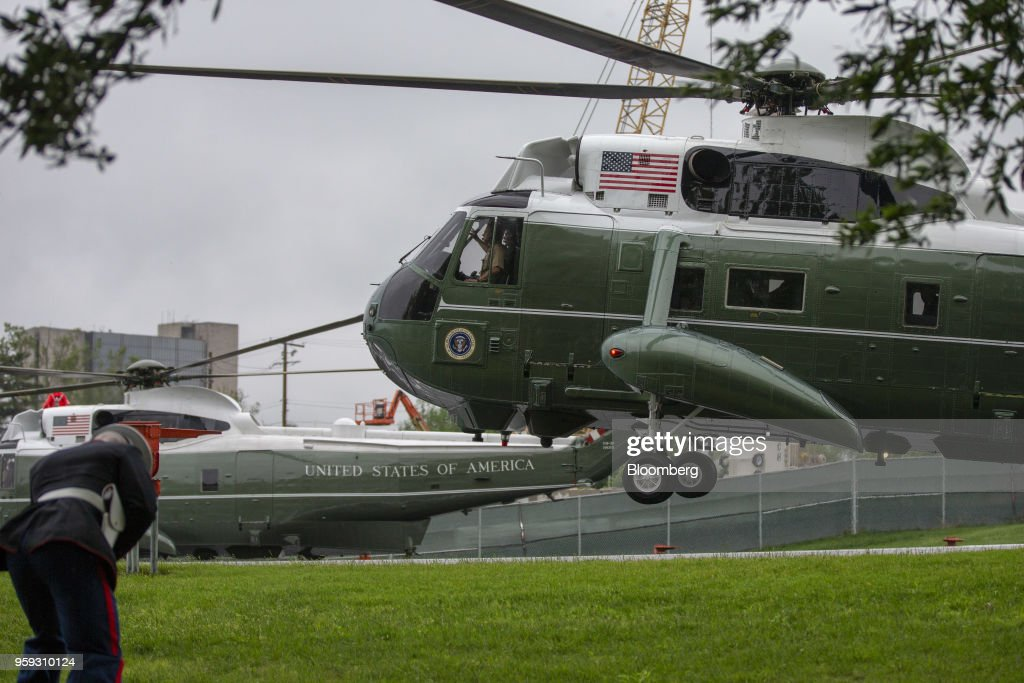 Marine One, carrying U.S. President Donald Trump, lands to visit First Lady Melania Trump at Walter Reed National Military Medical Center in Bethesda, Maryland, U.S., on Wednesday, May 16, 2018. Trump is visiting Walter Reed where Melania Trump underwent successful surgery to treat a kidney condition on Monday. Photographer: Alex Edelman/Pool via Bloomberg
